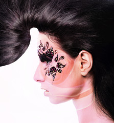 pink flower woman with creative hair and face art