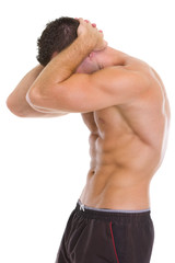Muscular man showing abdominal muscles