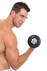 Athletic man with strong biceps rising dumbbell