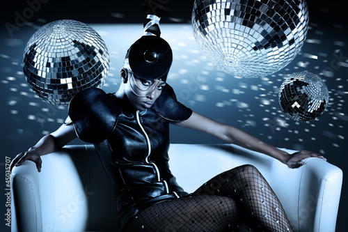 Attractive african woman with disco balls