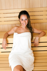 Beautiful girl in a sauna