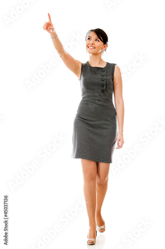 Businesswoman walking and pointing