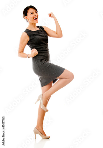 Successful business woman celebrating