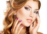 Beautiful woman face with bright makeup and manicure