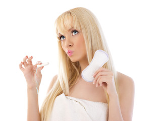 Pretty woman holding cotton hygienic tampon