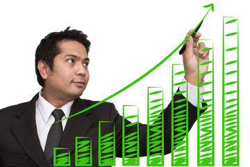 Businessman drawing  graph on the board