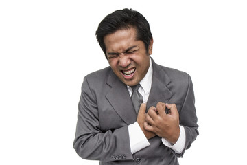 Businessman having heart attack