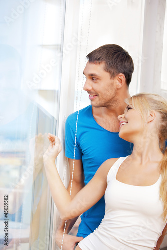 happy couple at the window