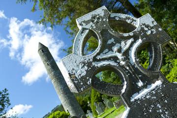 Stone cross with Round Tower, Glendalough, Ireland