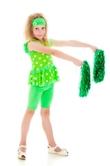 The girl in green with pompoms.