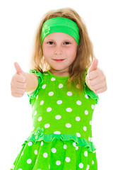 Smiling girl with thumbs up sign
