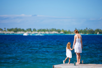 Mother and daughter at oceanfront