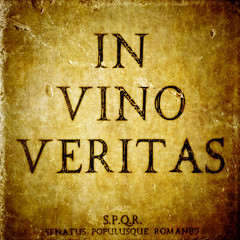 In vino veritas sign on a stone textured bacground