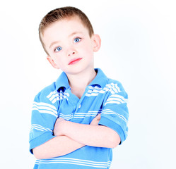 Young boy with arms crossed isolated on white