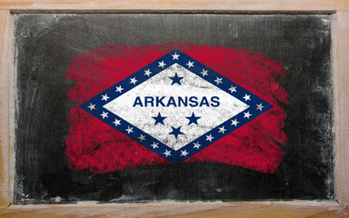 flag of US state of arkansas on blackboard painted with chalk