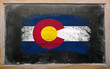 flag of US state of colorado on blackboard painted with chalk