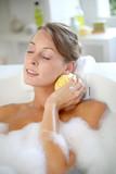 Beautiful woman relaxing in baththub