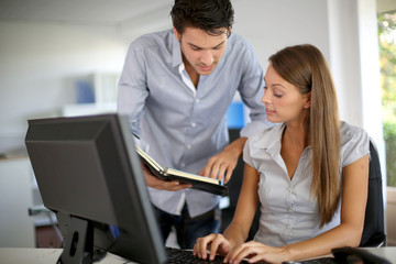 Business partners at work in front of desktop