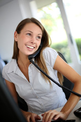 Beautiful office worker talking on the phone