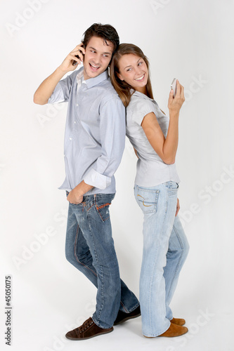 Cheerful couple using smartphone