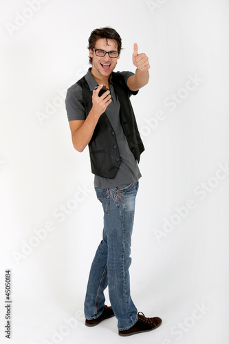 Cool guy with smartphone showing thumb up