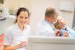 Smiling dental nurse prepare patient paperwork