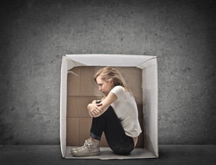 Blonde Girl Crouched in a Box