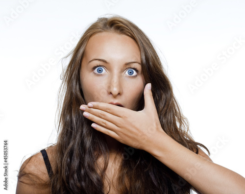 surprised girl covering her mouth