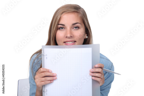 Blonde girl showing notebook