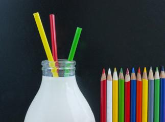 School milk, crayons and blackboard.