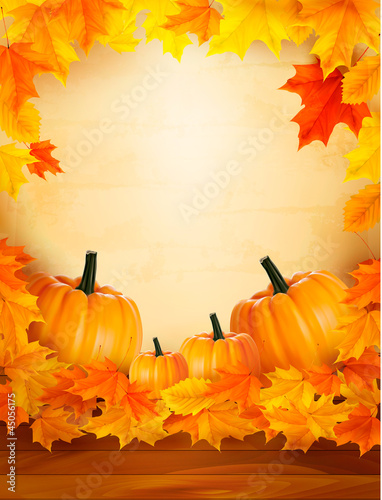Pumpkins on wooden background with leaves.