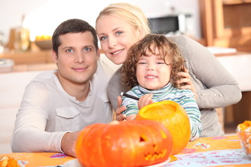 Family carving a pumpkin together