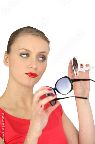 Woman choosing a pair of sunglasses
