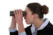 Woman watching through binoculars