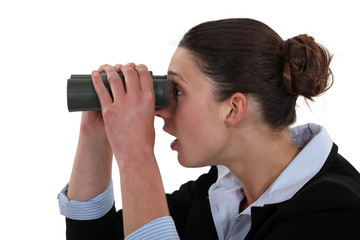 Woman watching through binoculars