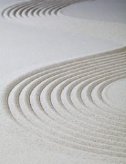 courbes dans le sable fin