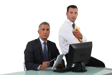 Two businessmen sat at desk