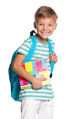 Little boy with exercise books
