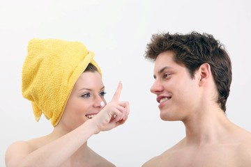 young woman and young man with lotion