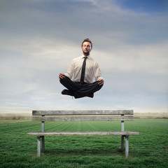 Businessman Levitating on a Bench