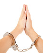 hands of praying woman with handcuffs, white background