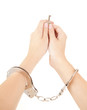 woman hands with handcuffs and key, white background