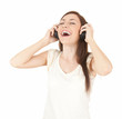 pretty young woman listening to her headphones and singing