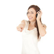 pointing on you young woman in headphones
