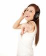 pointing on you casual girl in headphones