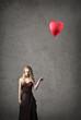 Holding a Balloon
