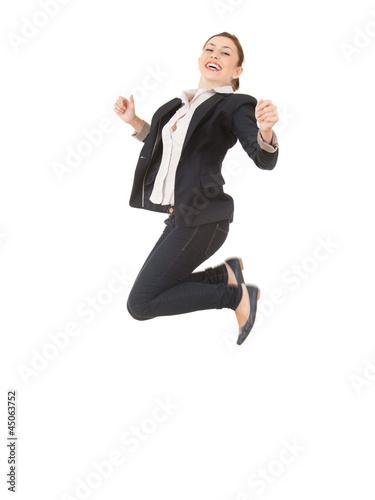 jumping happy businesswoman in dark jacket, full length