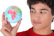 Teen with globe in hand