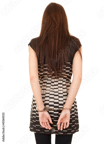 standing back young woman in handcuffs
