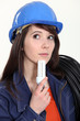 Thoughtful woman holding a compact fluorescent lamp